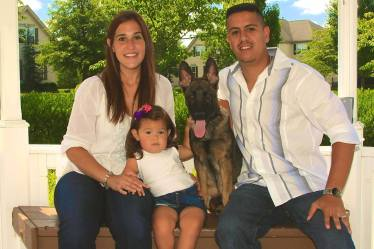 Green boy, K9 Averi with his family